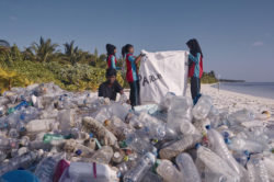 Collecting plastic waste, Photo: adidas